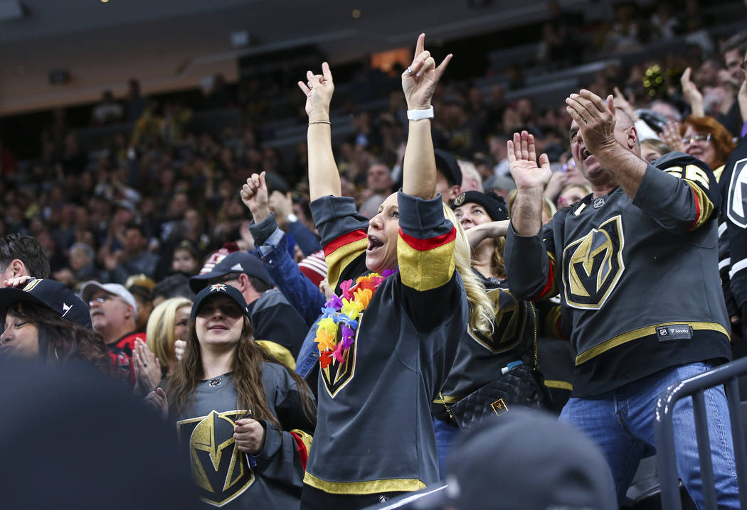 Golden Knights fans celebrate a goal by Golden Knights right wing Mark Stone, not pictured, dur ...