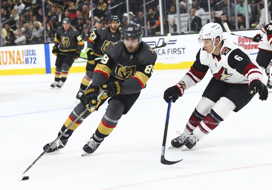 Golden Knights right wing Alex Tuch (89) moves the puck against Arizona Coyotes defenseman Jako ...