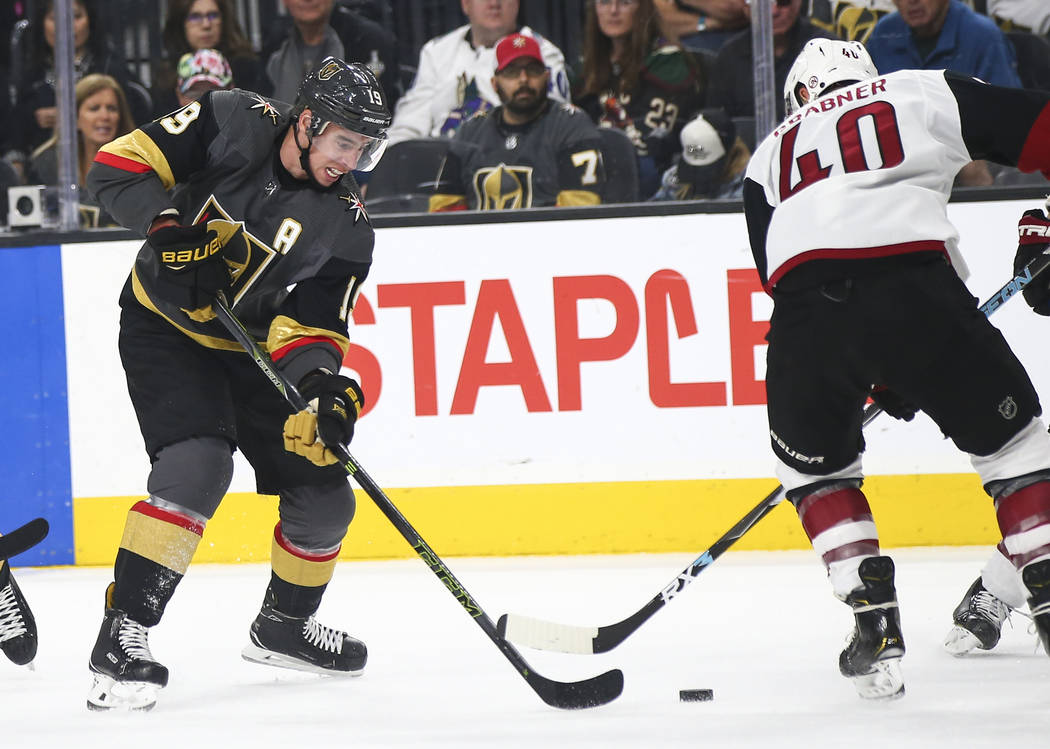 Golden Knights right wing Reilly Smith (19) moves the piuck around Arizona Coyotes right wing M ...