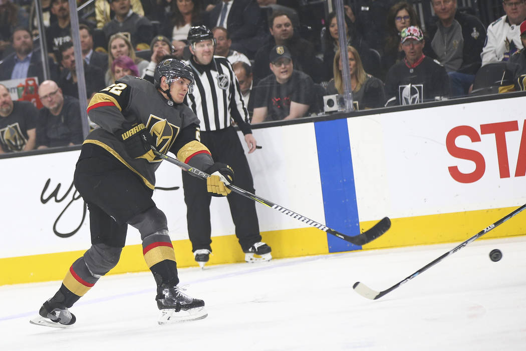 Golden Knights defenseman Nick Holden (22) shoots against the Arizona Coyotes during the first ...
