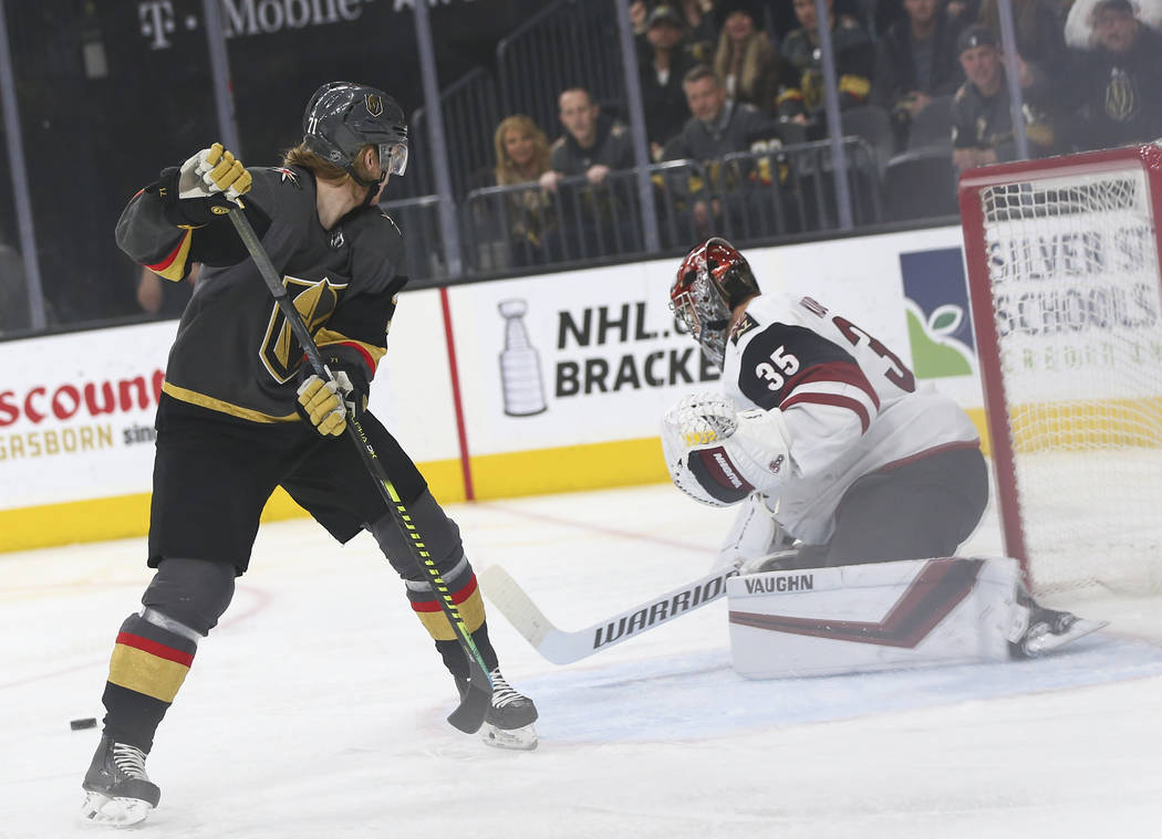 Golden Knights center William Karlsson (71) comes up short on a shot against Arizona Coyotes go ...