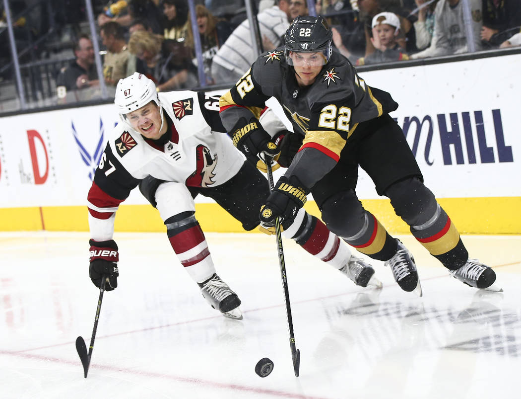Golden Knights defenseman Nick Holden (22) moves the puck past Arizona Coyotes left wing Lawson ...