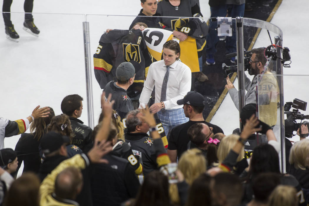 Golden Knights center Erik Haula joins other players in signing and giving away jerseys to luck ...