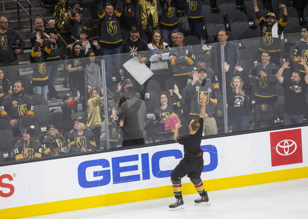 Golden Knights defenseman Nate Schmidt throws a t-shirt into the crowd during the postgame &quo ...