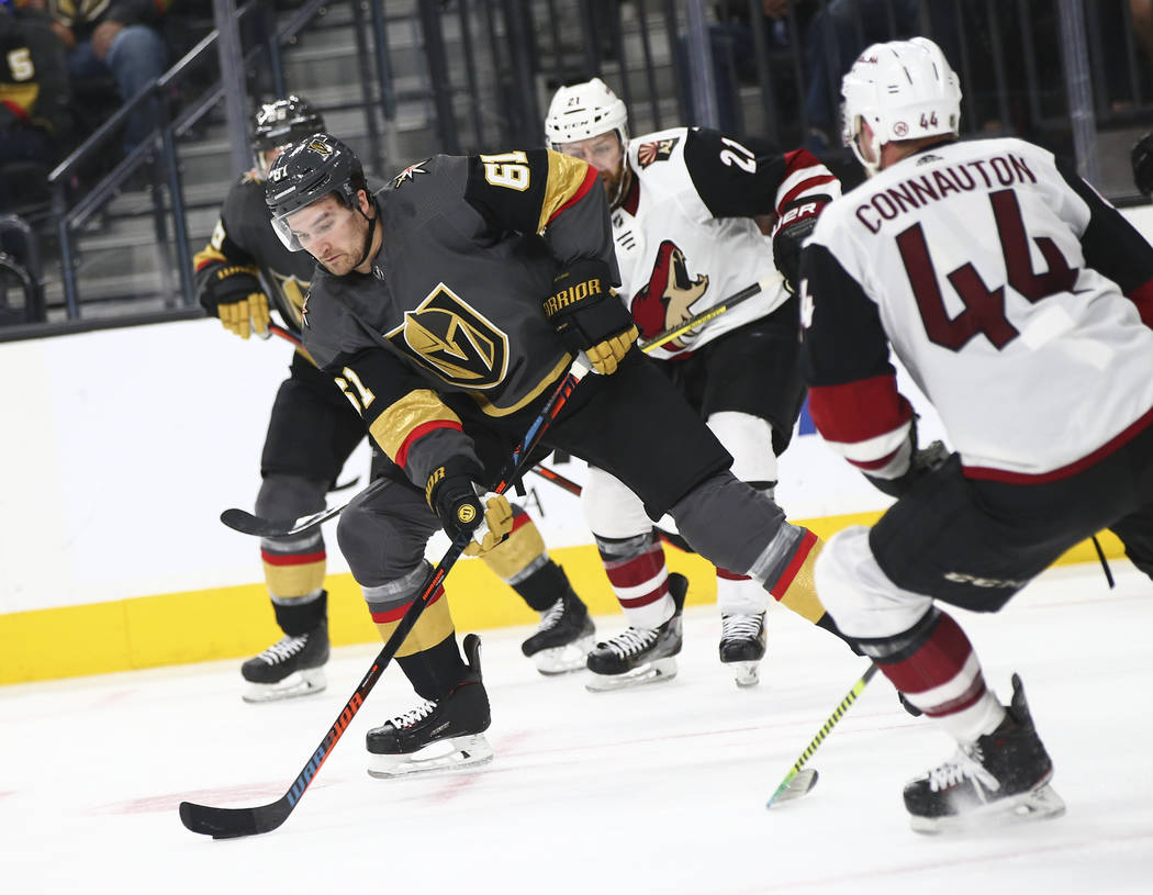Golden Knights right wing Mark Stone (61) moves the puck around Arizona Coyotes defenseman Kevi ...