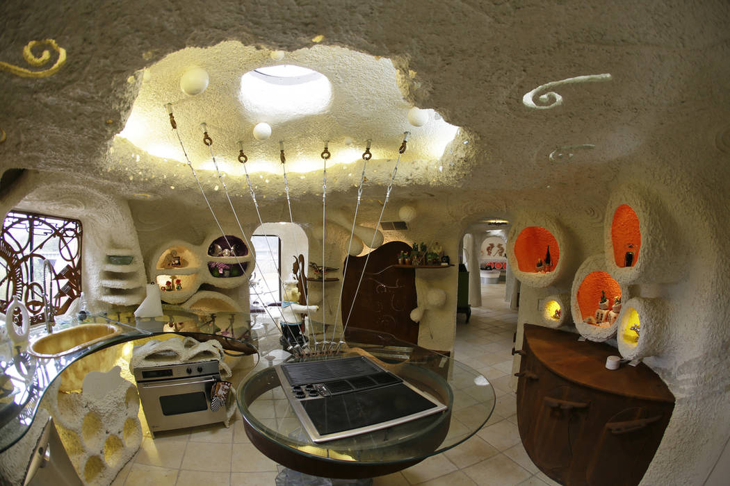 In this photo taken Monday, April 1, 2019, is the kitchen inside the Flintstone House in Hillsb ...