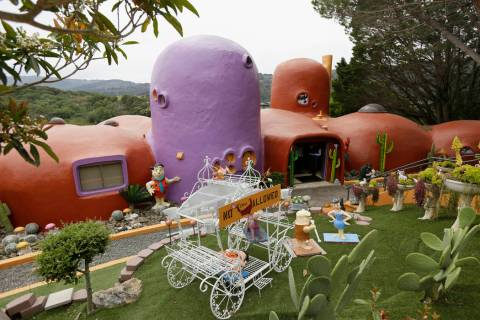 In this photo taken Monday, April 1, 2019, is an exterior view of the Flintstone House in Hills ...