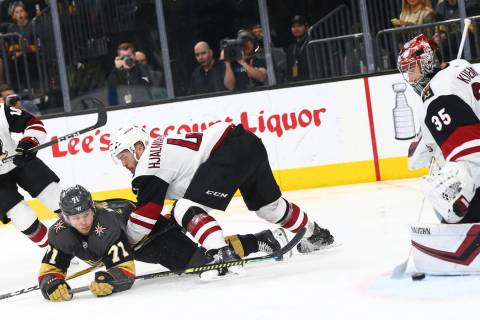 Golden Knights center William Karlsson (71) slips on the ice while trying to get the puck in ag ...