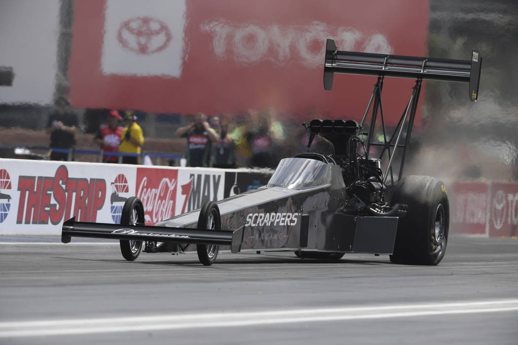 In this photo provided by the NHRA, Mike Salinas drives in the first day of Top Fuel qualifying ...