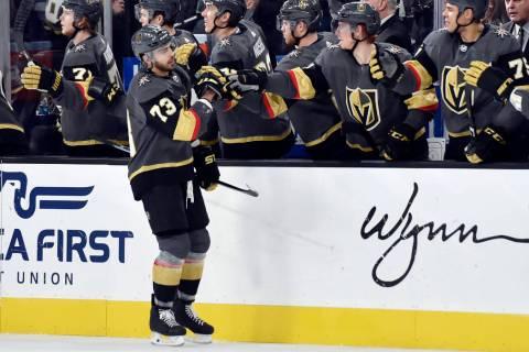 Vegas Golden Knights forward Brandon Pirri (73) gets fist bumps from teammates after scoring a ...