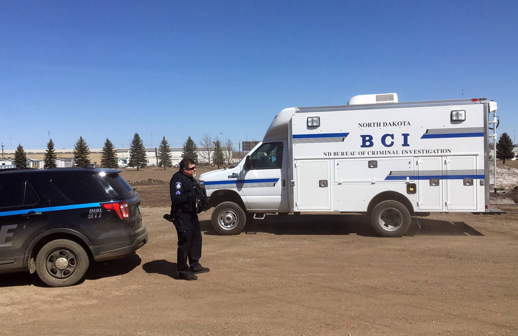 In this Wednesday, April 3, 2019 photo, state and local police search a field in Manton, N.D., ...