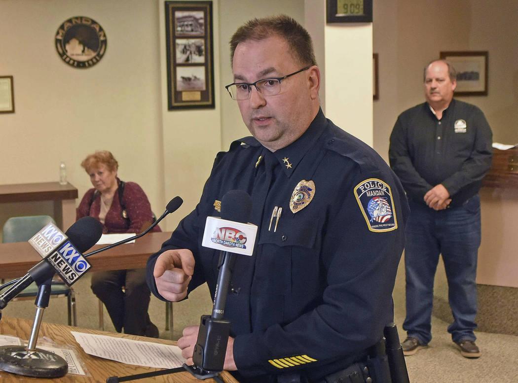 Mandan Police Chief Jason Ziegler announces an arrest in a quadruple homicide at a press confer ...