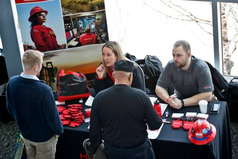 Visitors to a Pittsburgh veterans job fair meet with recruiters at Heinz Field on March 7, 2019 ...