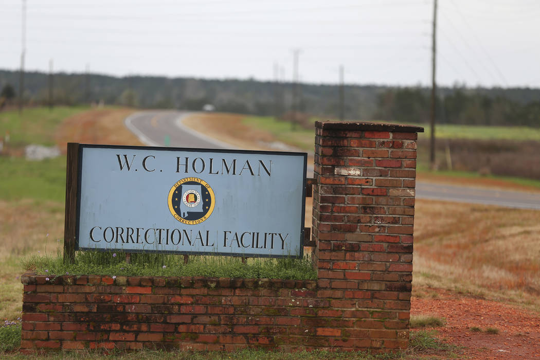 A sign to The William C. Holman Correctional Facility in Atmore, Ala., is displayed March 12, 2 ...