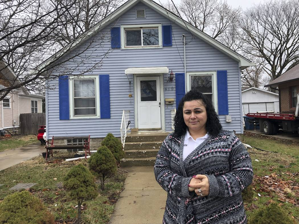 Linda Ramirez stands in front of her house in Aurora, Ill., Thursday, April 4, 2019, where she ...