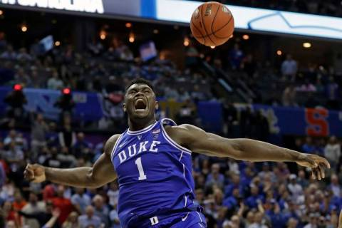 Duke's Zion Williamson (1) reacts after a dunk against North Carolina during the second half of ...