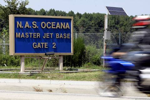 A motorcycle rider approaches the entrance to the Oceana Naval Air Station in Virginia Beach Va ...