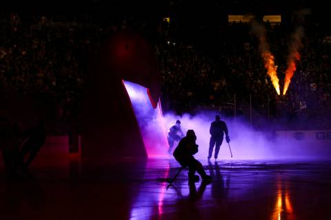 Golden Knights players skate onto the ice before the start of an NHL hockey game against the Ar ...