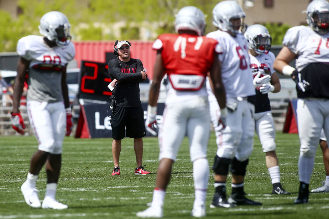 UNLV Rebels head coach Tony Sanchez watches his team during the spring football game at Peter ...