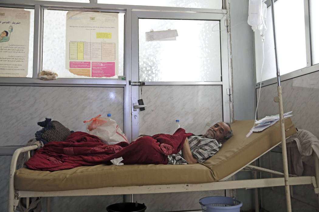 A man is treated for suspected cholera infection on March 28, 2019, at a hospital in Sanaa, Yem ...