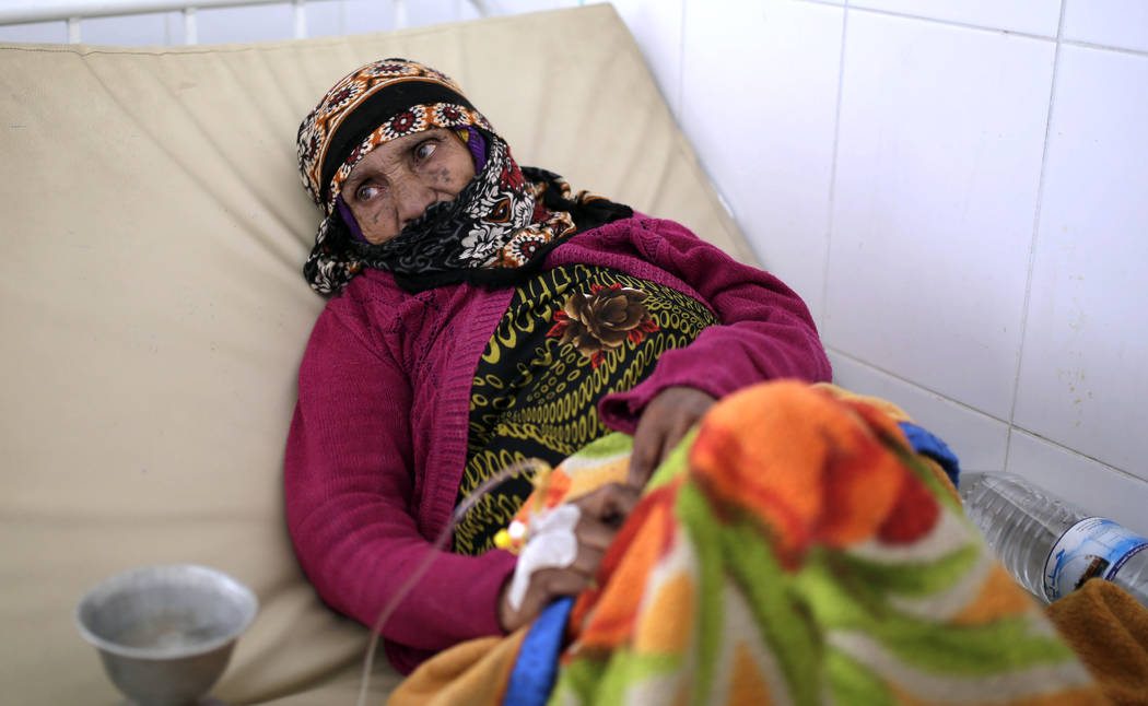 An elderly woman is treated for suspected cholera infection at a hospital in Sanaa, Yemen on Ma ...