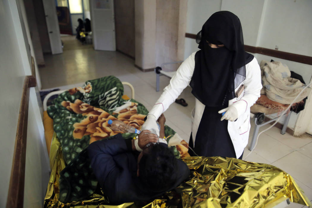 A man is treated for suspected cholera infection at a hospital in Sanaa, Yemen on March 28, 201 ...