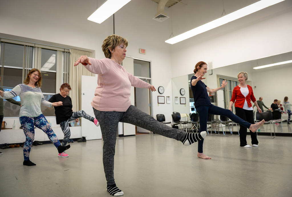 People participate in a ballet class for individuals with Parkinson's disease lead by Pamela La ...