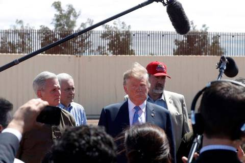 President Donald Trump visits a new section of the border wall with Mexico in Calexico, Calif., ...
