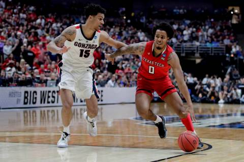 Texas Tech guard Kyler Edwards drives to the basket around Gonzaga forward Brandon Clarke durin ...
