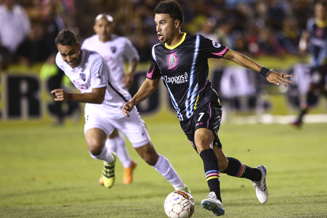 Las Vegas Lights FC midfielder Carlos Alvarez (7) moves the ball past San Antonio FC defender R ...