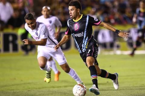 Las Vegas Lights FC midfielder Carlos Alvarez (7) moves the ball past San Antonio FC defender R ...