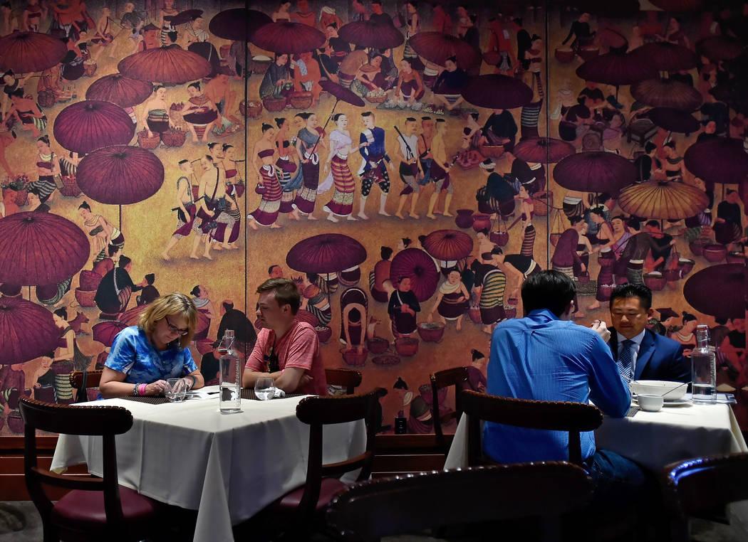 Many murals decorate the dining room at Lotus of Siam restaurant in Las Vegas. (David Becker/La ...