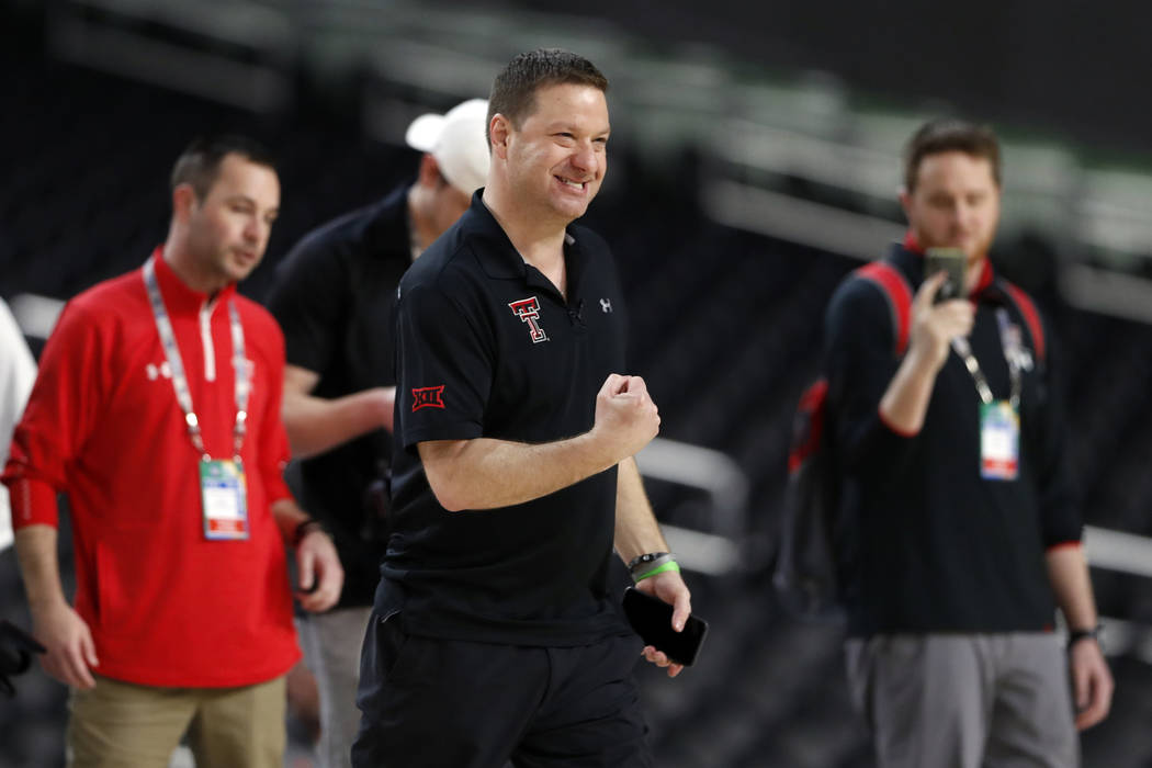 Texas Tech head coach Chris Beard pumps his fist during a practice session for the semifinals o ...