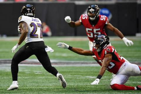 Atlanta Falcons' Jordan Richards (29) and Bruce Carter (55) defend against Baltimore Ravens cor ...