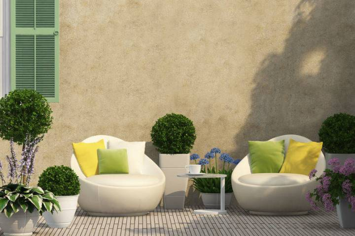 A courtyard provides a cozy place for coffee in the morning and entertaining guests at night. ( ...