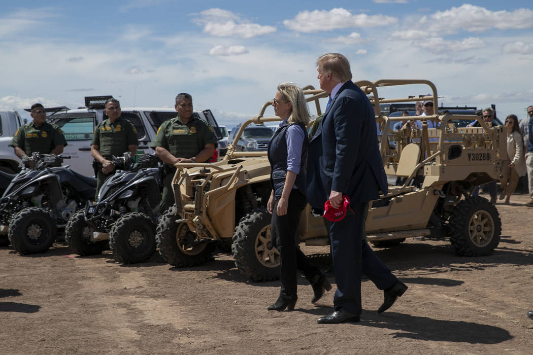 President Donald Trump walks with Homeland Security Secretary Kirstjen Nielsen as they visit a ...