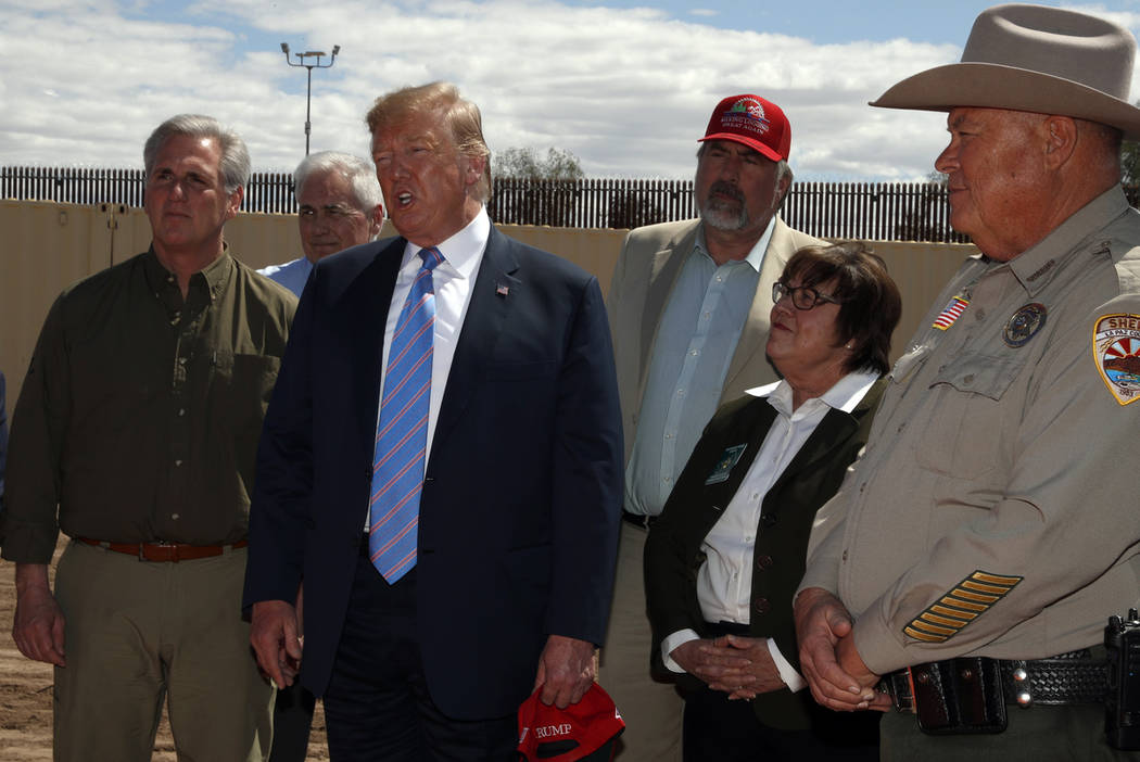 President Donald Trump speaks as he visits a new section of the border wall with Mexico in Cale ...