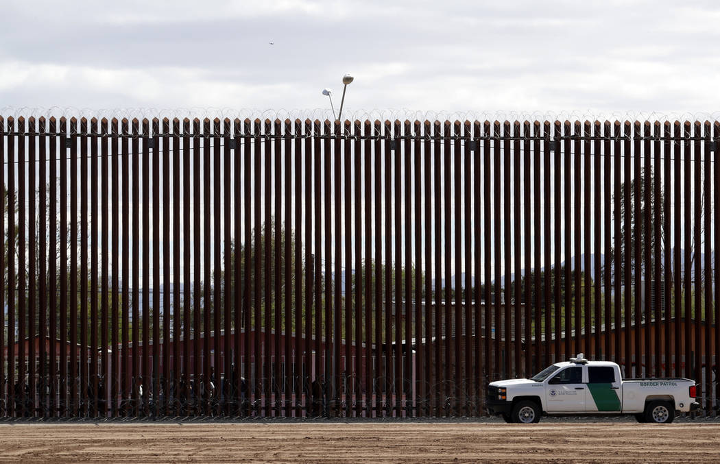 A U.S. Customs and Border Protection vehicle sits near the wall as President Donald Trump visit ...