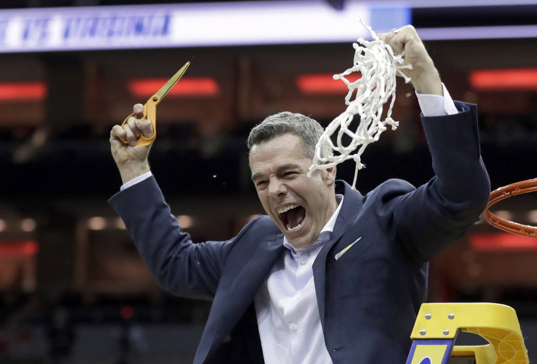 Virginia head coach Tony Bennett celebrates after defeating Purdue 80-75 in overtime of the men ...