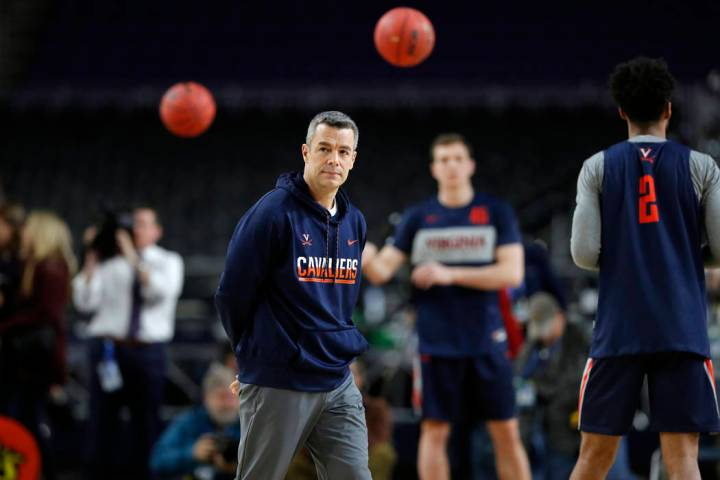 Virginia head coach Tony Bennett watches his team during a practice session for the semifinals ...