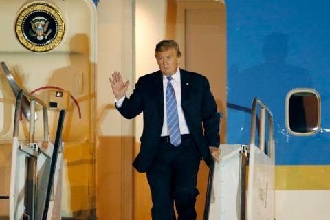 President Donald Trump disembarks from Air Force One after arriving at McCarran International A ...