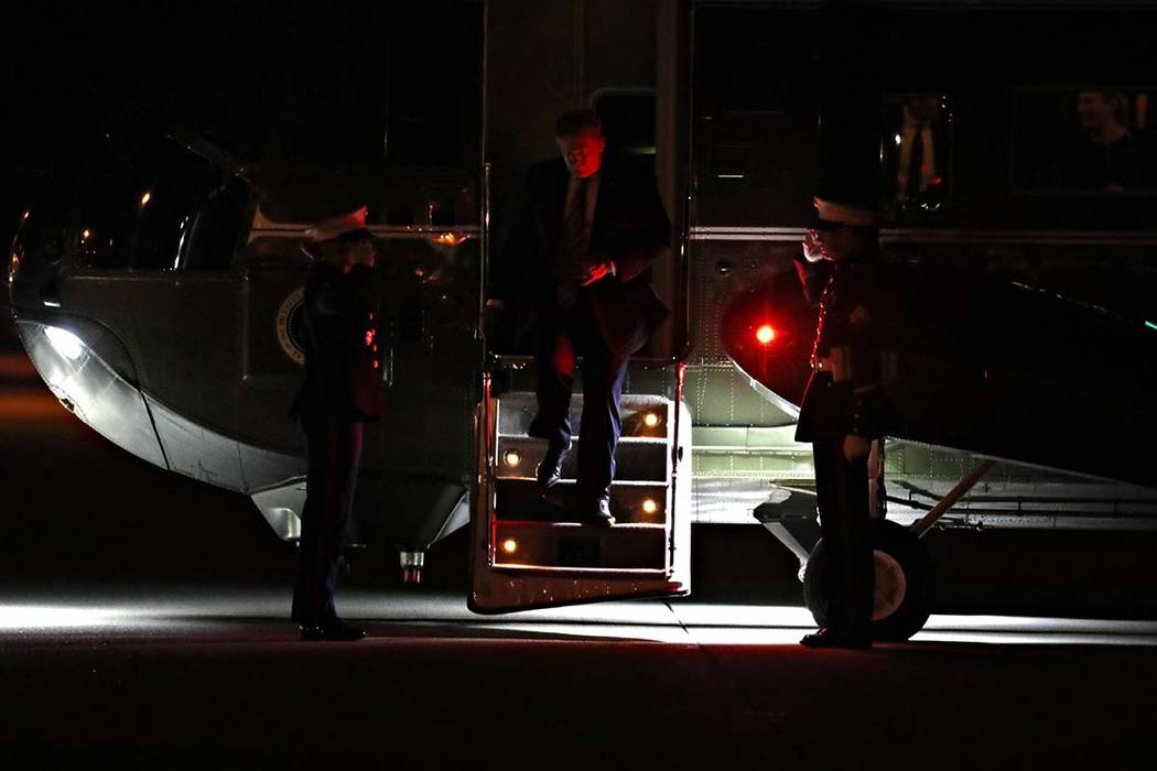 President Donald Trump exits the Marine One helicopter to board Air Force One at Los Angeles In ...