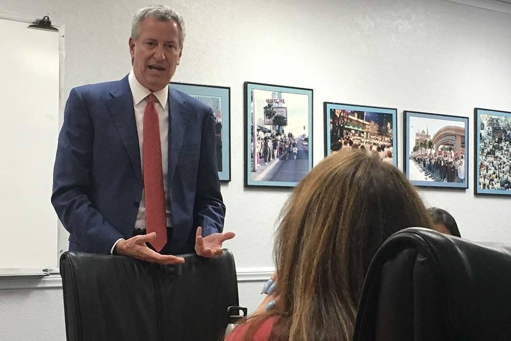 New York City Mayor Bill de Blasio speaks with local Culinary union members at their headquarte ...