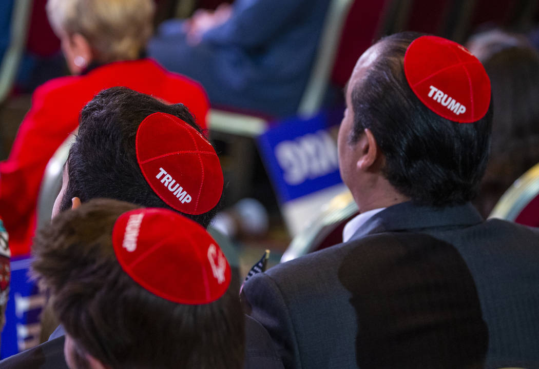 Attendees wear Trump yamakas as they await President Donald J. Trump to address the Republican ...