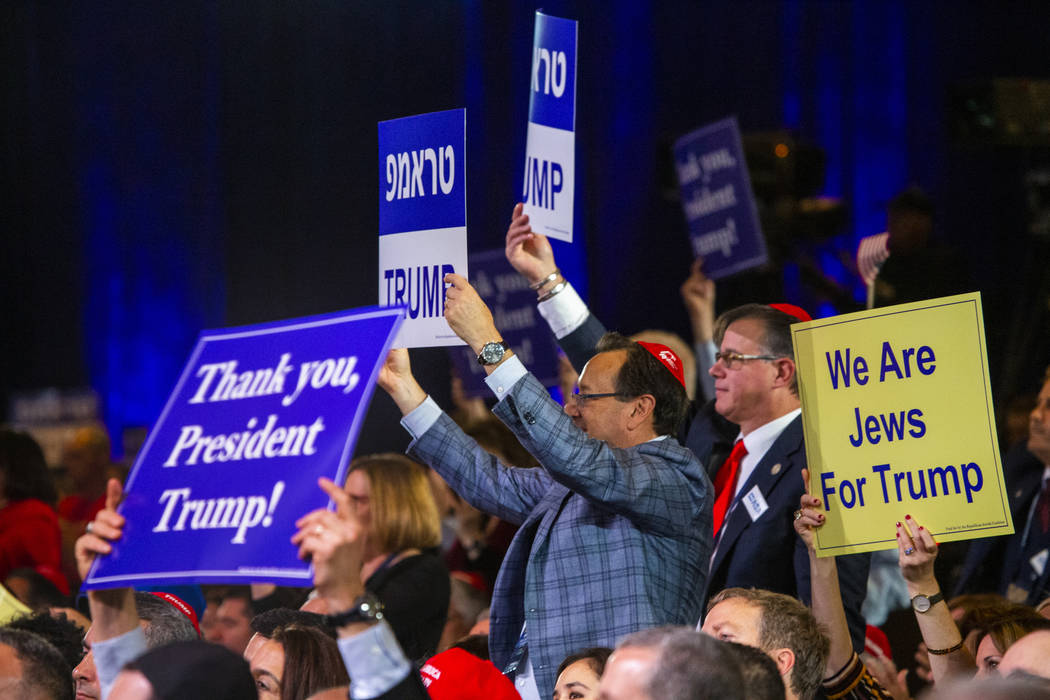 Attendees applaud President Donald J. Trump while he addresses the Republican Jewish Coalition ...