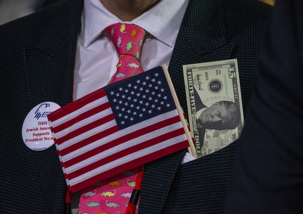 An attendee is decked out as President Donald J. Trump addresses the Republican Jewish Coalitio ...