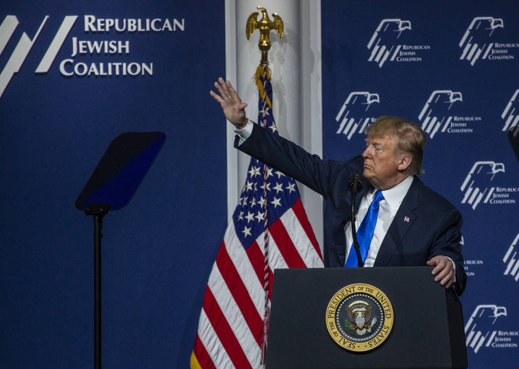 President Donald J. Trump waves to an invited guest as he addresses the Republican Jewish Coali ...