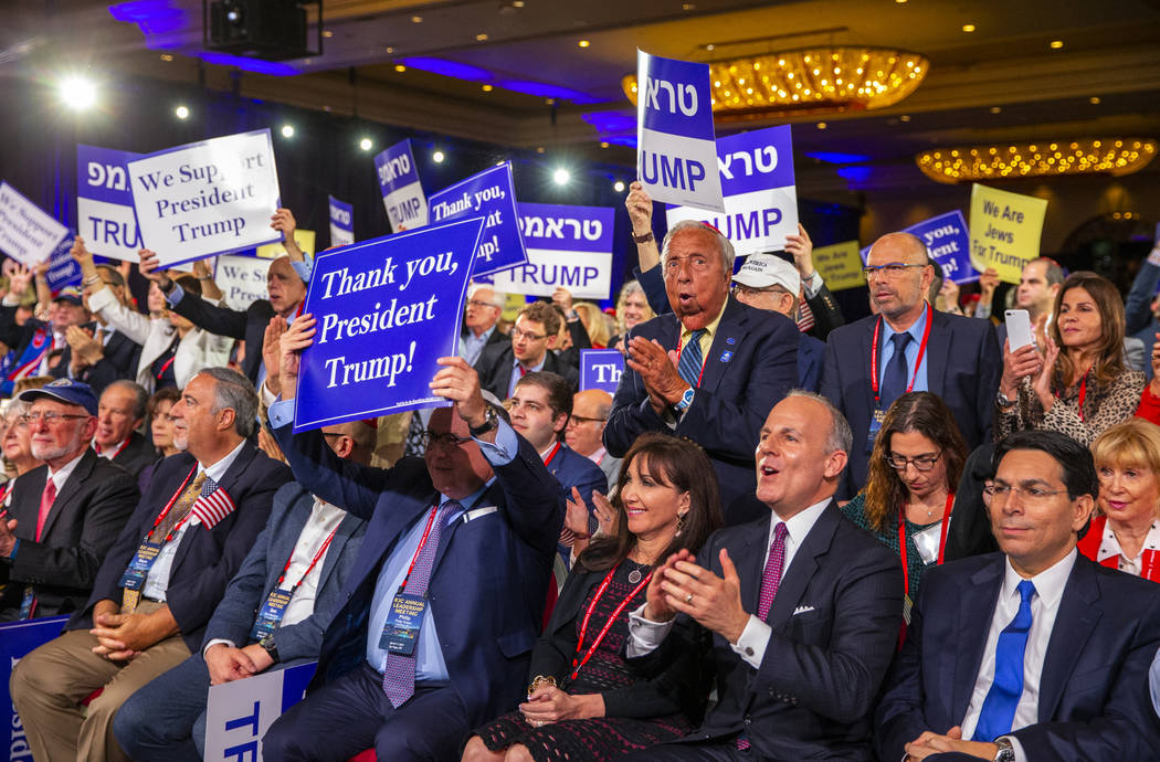 Attendees applaud as President Donald J. Trump completes his address to the Republican Jewish C ...
