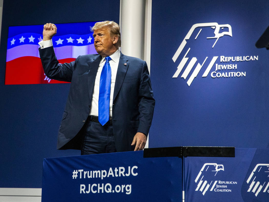 President Donald J. Trump thanks the crowd after addressing the Republican Jewish Coalition dur ...