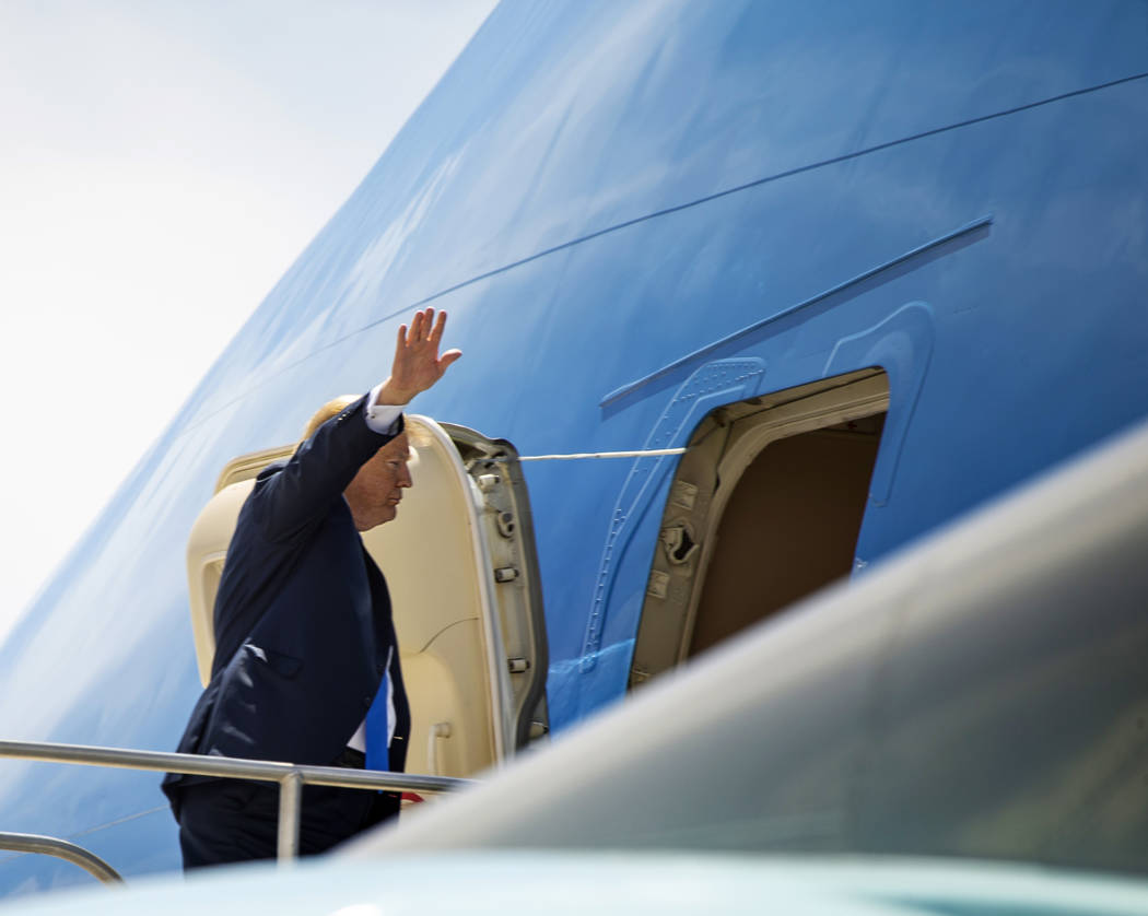 President Donald J. Trump waves as he readies to depart from McCarran International Airport on ...